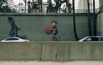 mural of child holding a basketball
