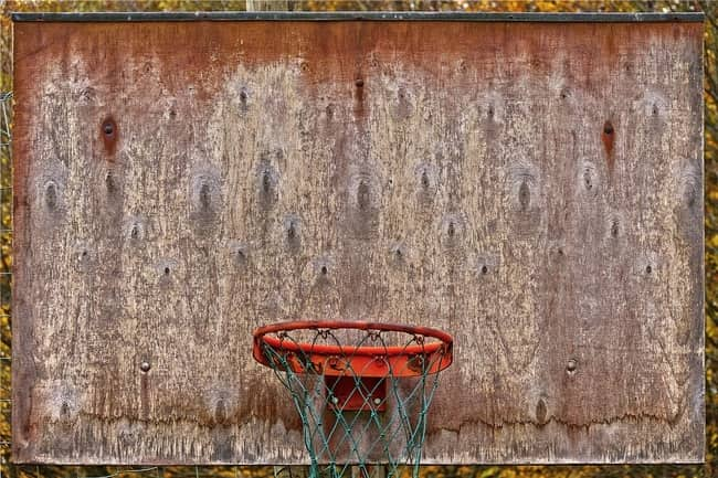 Picture of an old basketball hopp and rim.