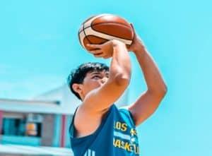 Basketball Player Shooting the basketball upclose with perfect form.