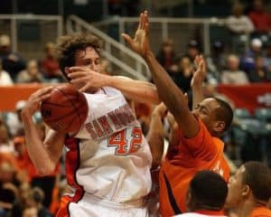 Player being fouled going up for a shot in basketball