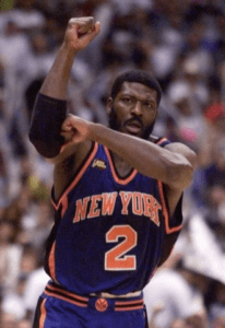 Larry Johnson making the his patent L with his arms in a knicks unifrom
